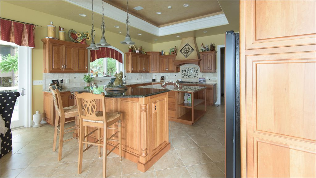 The 7,600-square-foot home's dining room and kitchen are on the main, upper level.