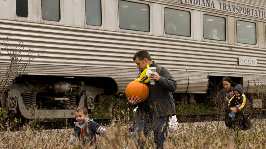 Josh and Lacie Stowers, along with sons Oren (left) and Mason, head back to the train with full hands.