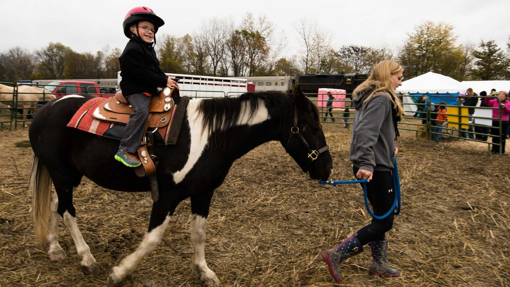 : Pony rides heighten the day's excitement for some of the youngest passengers.