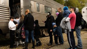 Guests board the Harvest Train in Fishers. ITM volunteers serve as ticket-takers.