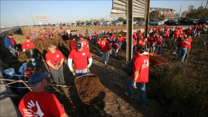 Eli Lilly and Co. has more than 8,000 workers sprucing up a six-mile stretch of I-70 between the airport and downtown.