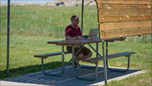 Jon Arnold took advantage of a rest area in The Badlands of South Dakota in late June to catch up on work after using the first week on the road as a vacation.