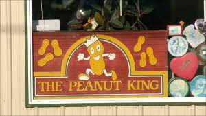 A vintage Peanut King sign in Richard Green Co.'s window. The Indianapolis company got its start in 1957 selling peanut vending machines.