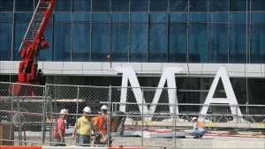 Crews gave the JW Marriott an identity in September, hoisting giant letters to the top of the 34-story hotel downtown.