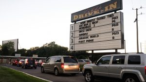 Cars line up long before sunset on Saturday nights to get into the west-side Tibbs Drive-In Theatre.