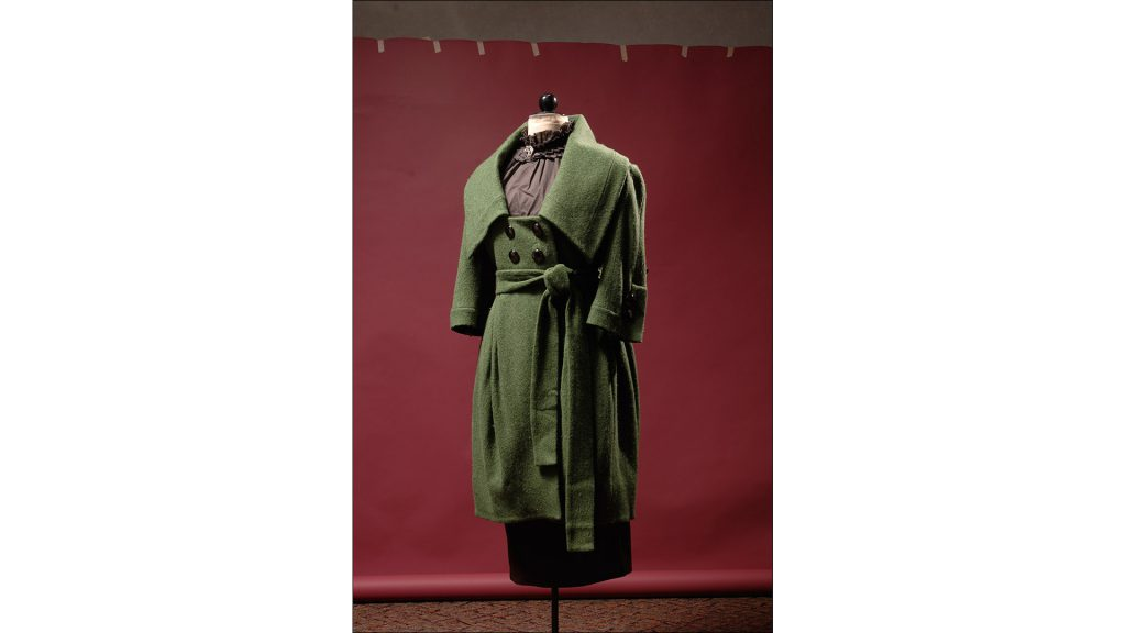 Wool coat in moss green with oversized collar and pewter buttons by Rodriguez, $759, at Frankey's