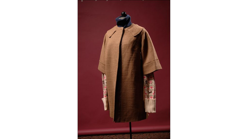 Boucle coat in camel with bracelet-length sleeves and faux collar by Milly, $640, at Nordstrom at the Fashion Mall. Perfect to wear with this season's accessory trend, gloves, this fall jacket is very Jackie O.